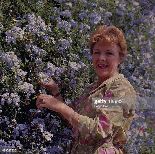 English actress Noele Gordon posed in the garden of her RossonWye house in 1967