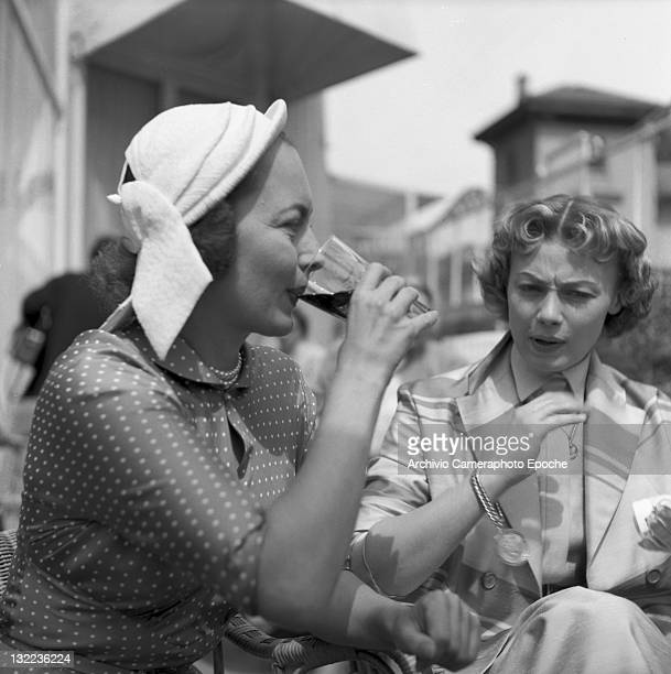 English actress Olivia de Havilland drinking a soda Lido Venice 1953