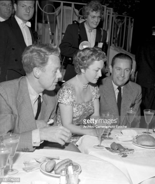 English actress Olivia de Havilland having dinner with her husband Marcus Goodrich and the actor Van Johnson Lido Venice 1953