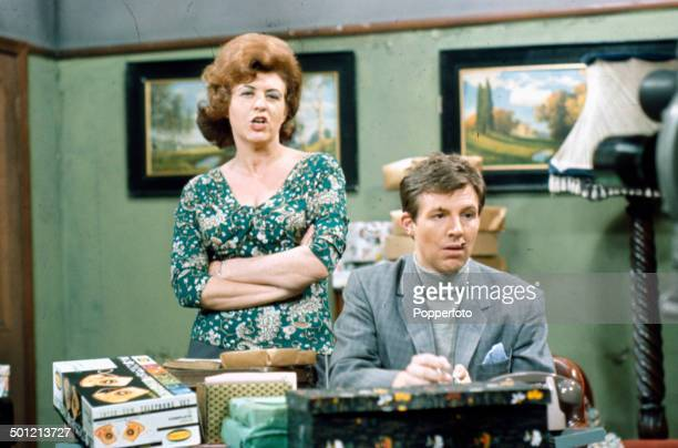English actress Pat Phoenix as 'Elsie Tanner' and actor Philip Lowrie as 'Dennis Tanner' pictured together in a scene from the television soap opera...