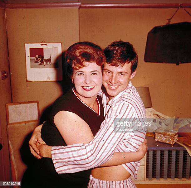 English actress Pat Phoenix posed with actor Philip Lowrie in their roles as Elsie Tanner and Dennis Tanner from the long running television soap...