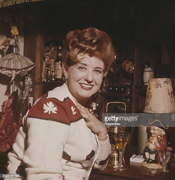English actress Pat Phoenix who plays the character of Elsie Tanner in the television soap opera Coronation Street pictured at a domestic drinks bar...