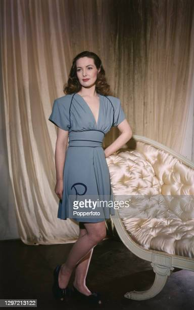 English actress Patricia Roc wears a saxe blue crepe short nightdress with 'P' monogram by Honore, in London in April 1947.