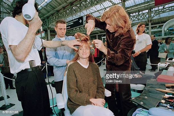 English actress Patsy Palmer has her hair cut by stylist Nicky Clarke at Victoria railway station in London UK 7th October 1996