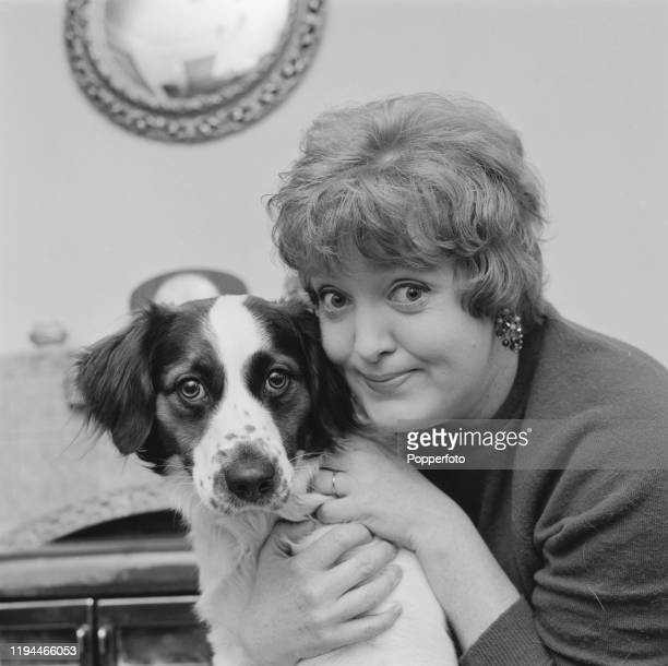 English actress Patsy Rowlands posed with a pet dog at home in December 1967