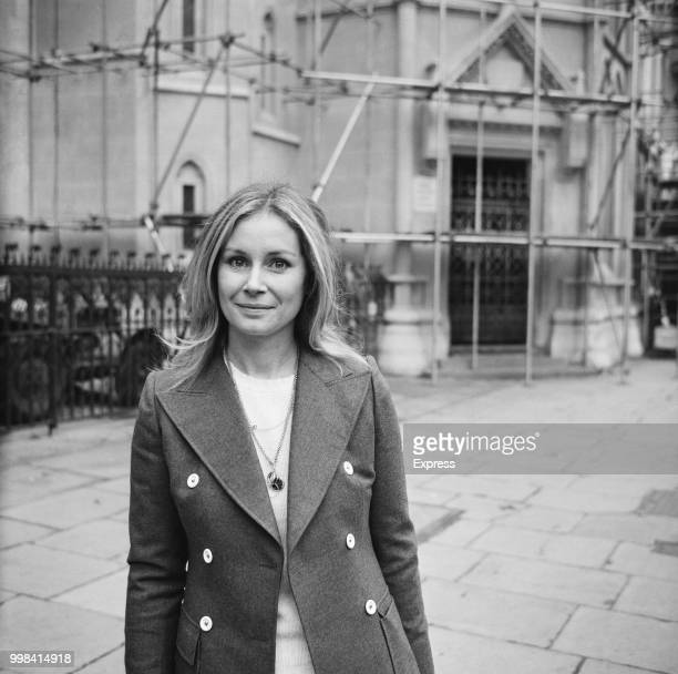 English actress Penelope Horner pictured standing outside the Royal Courts of Justice on The Strand in London on 1st December 1973