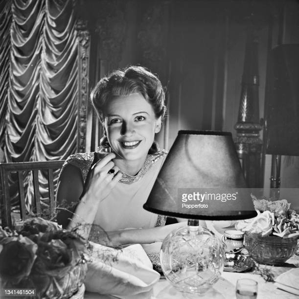 English actress Phyllis Calvert plays the role of Julie Lanvin during shooting of the British World War II drama film 'Uncensored' for Gainsborough...