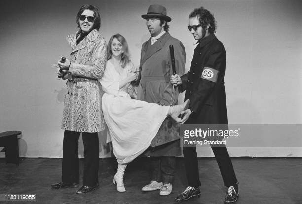 English actress Polly James posed with from left Mike McGear John Gorman and Roger McGough of the music trio The Scaffold on 3rd November 1970