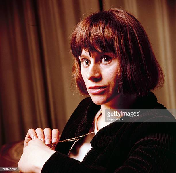English actress Rita Tushingham posed holding a necklace in 1965