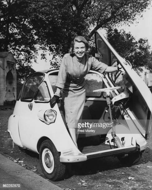 English actress Sally Bazely test drives a BMW Isetta at Battersea Park London 17th October 1955 She is starring in Sandy Wilson's 'The Buccaneer' at...