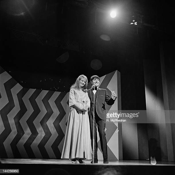English actress Sarah Miles on stage with comedian Jimmy Tarbuck at the London Palladium 26th September 1965