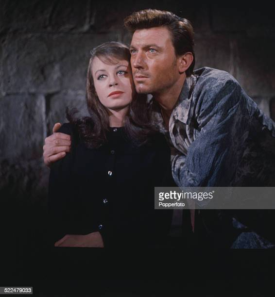 English actress Sarah Miles pictured with British actor Laurence Harvey in a scene from the film 'The Ceremony' in 1963