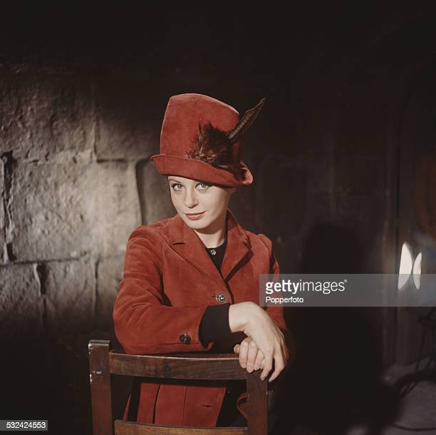English actress Sarah Miles posed wearing a red suede jacket with matching red hat in 1963