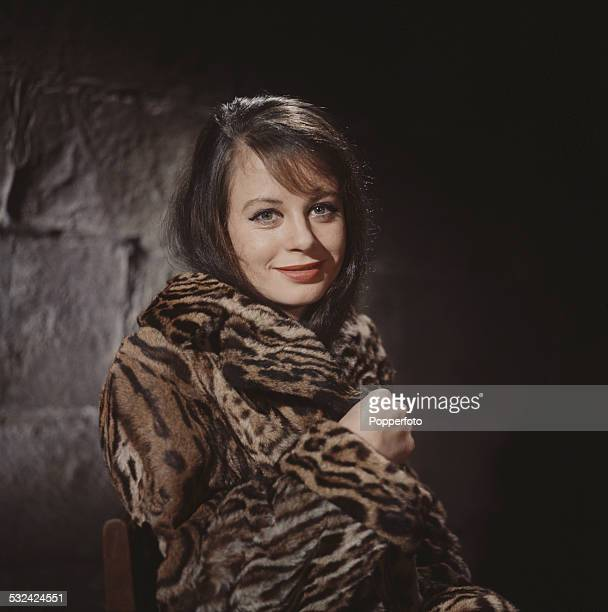 English actress Sarah Miles posed with a fur style coat wrapped around her in 1963