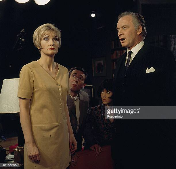 1968 English actress Sheila Hancock pictured with Tony Britton in a scene from the television drama 'Horizontal Hold' in 1968 Behind them are Robert...
