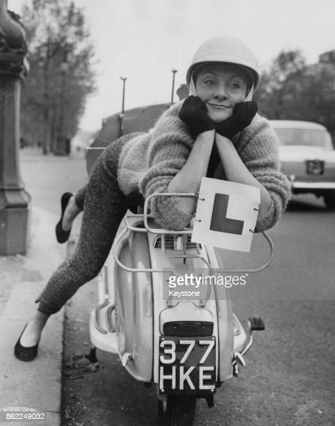 English actress Sheila Hancock with her new motor scooter complete with 'L' plates 24th October 1959 She is starring in the show 'Make Me an Offer'...