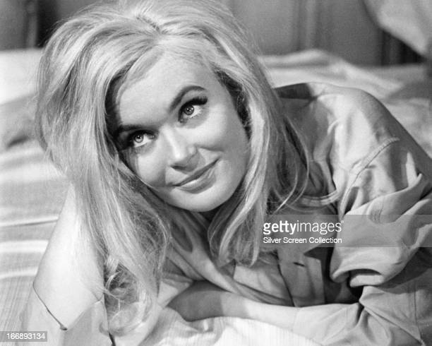 English actress Shirley Eaton as Jill Masterson in the James Bond film 'Goldfinger' directed by Guy Hamilton 1964