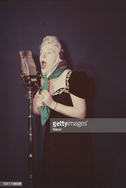 English actress singer and comedian Gracie Fields performs on Radio Luxembourg circa 1955