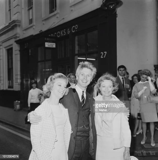 English actress singer and dancer Anna Neagle with costar Joe Brown in musical comedy 'Charlie Girl' and her understudy American actress Sheila...