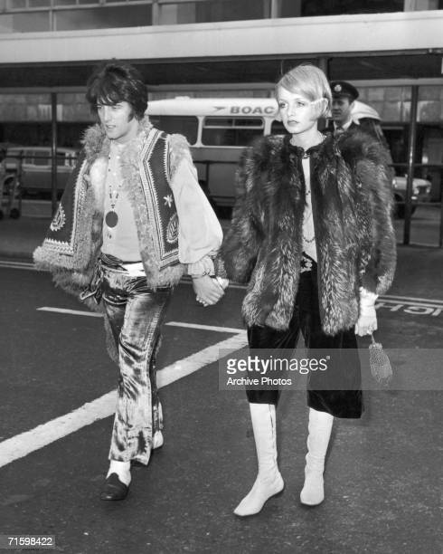 English actress singer and fashion model Twiggy with her boyfriend and manager Justin de Villeneuve at London Airport from whence they travel to...
