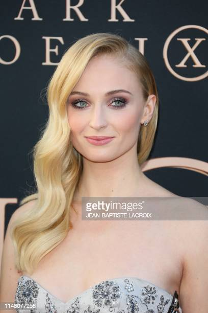 """English actress Sophie Turner arrives for the """"Dark Phoenix"""" premiere at the TCL Chinese theatre IMAX in Hollywood on June 4, 2019."""
