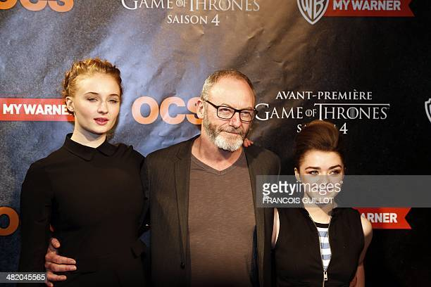 English actress Sophie Turner Irish actor Liam Cunningham and English actress Maisie Williams pose during a photocall for the premiere of the fourth...