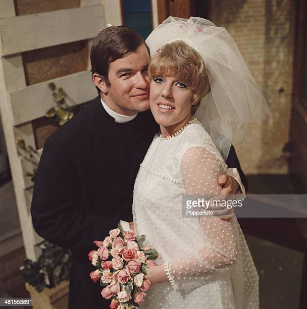 English actress Sue Nicholls as 'Marilyn Gates' and Welsh actor Neville Hughes as 'Rev Peter Hope' in a scene from the long running television soap...