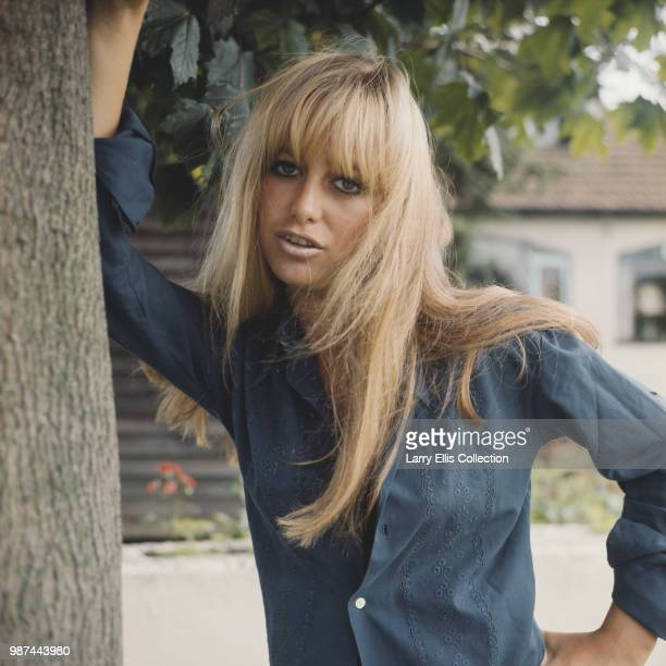 English actress Susan George posed wearing a blue blouse in England in 1972