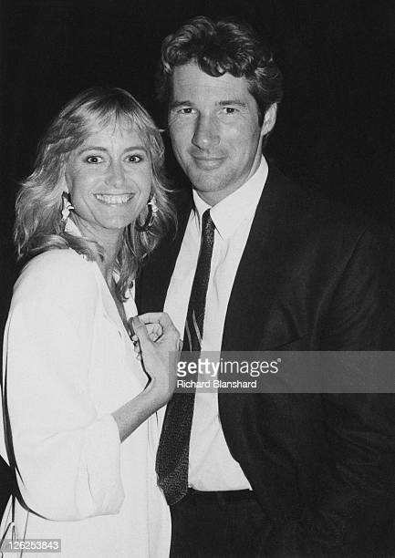 English actress Susan George poses with American actor Richard Gere probably at the Cannes Film Festival in France circa 1988