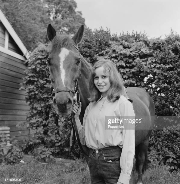 English actress Susan George, who appears in the television soap opera Weavers Green, holding the bridle of a horse in June 1966.
