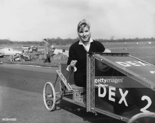 English actress Susan Hampshire joins a team of debutantes for the Easter holiday Gravity Power Grand Prix at Brands Hatch England 23rd March 1959...