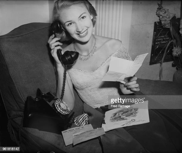 English actress Susan Shaw receives cards telegrams and telephone calls on her 21st birthday at her London apartment 29th August 1950