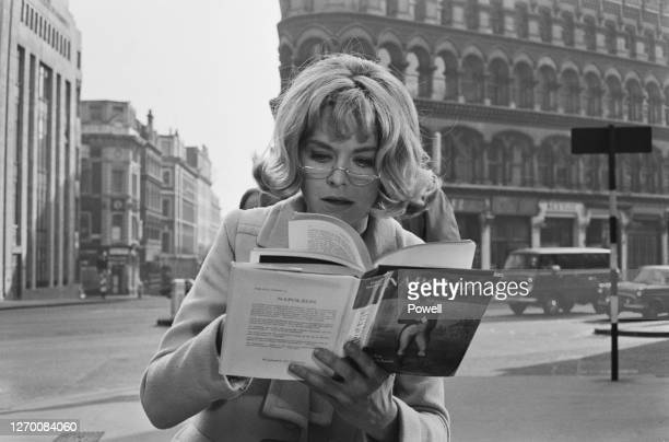 English actress Susannah York reading a book on Napoleon by Felix Markham during the filming of the crime movie 'Kaleidoscope' at Mansion House,...