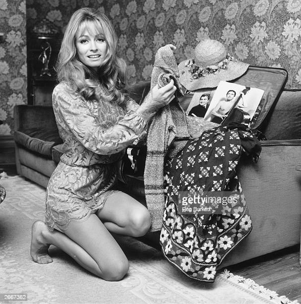 English actress Suzy Kendall packing her suitcase for a film location trip to Miami