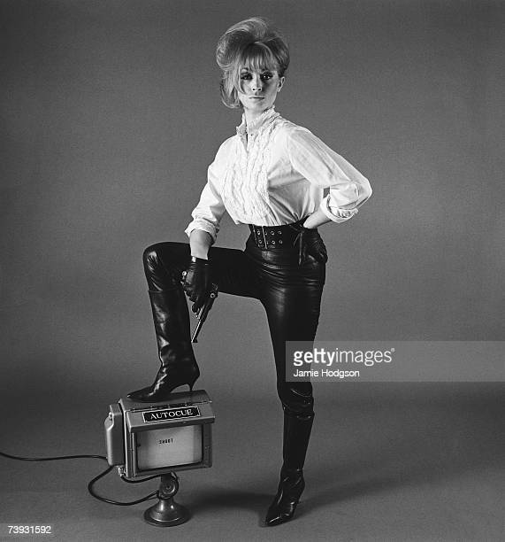 English actress Suzy Kendall with her foot up on an autocue 29th October 1963