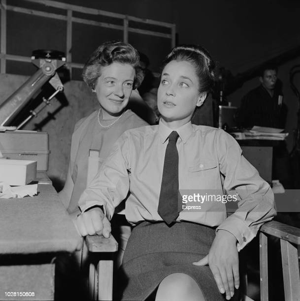 English actress Sylvia Syms and British journalist and writer Constance Babington Smith on the set of spy thriller film 'Operation Crossbow', UK, 6th...