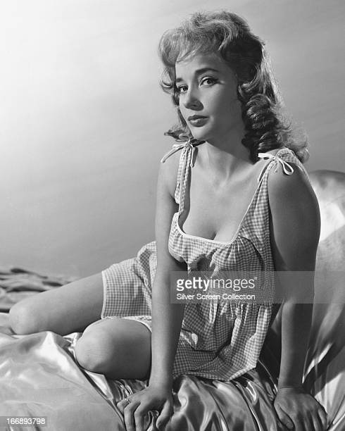 English actress Sylvia Syms in a gingham nightdress circa 1960