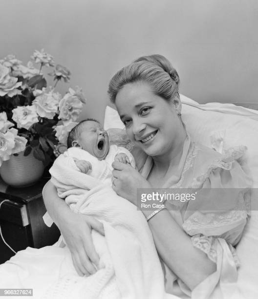 English actress Sylvia Syms with her baby daughter Beatrice at the Avenue Nursing Home in London 26th October 1962 Beatrice's father is store...