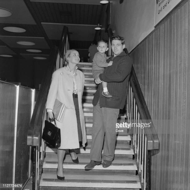 English actress Sylvia Syms with her husband Alan Edney and their son Benjamin Edney at Heathrow Airport London UK 12th August 1963
