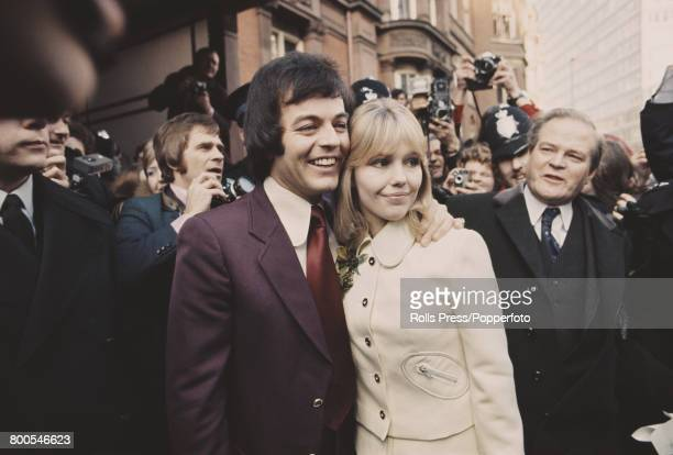 English actress Tessa Wyatt and disc jockey and broadcaster Tony Blackburn stand together in front of reporters, photographers and members of the...