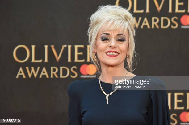 English actress Tracie Bennett poses on the red carpet upon arrival to attend The Olivier Awards at the Royal Albert Hall in central London on April...