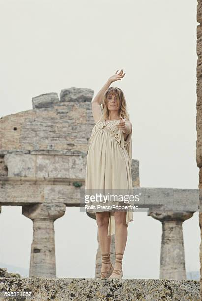 English actress Vanessa Redgrave pictured in character wearing a chiton garment as Isadora Duncan during production of the film 'Isadora' amid the...