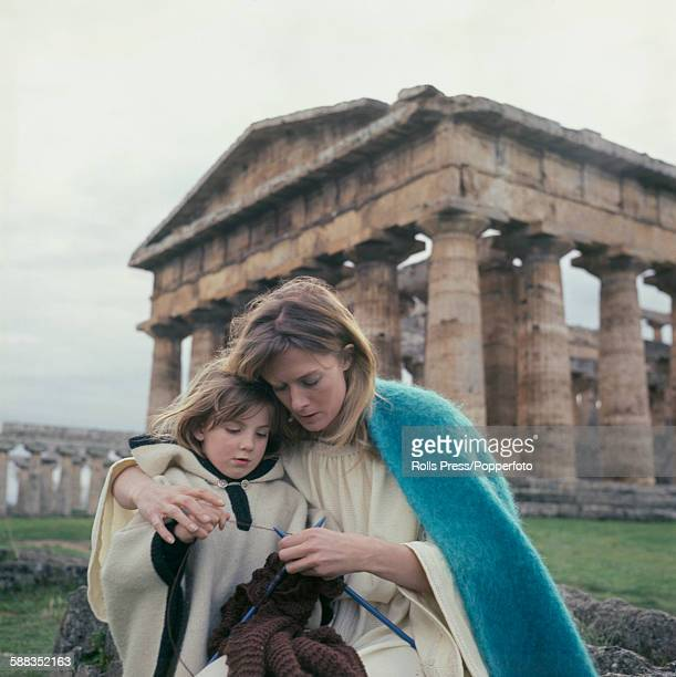 English actress Vanessa Redgrave pictured teaching her daughter Natasha Richardson how to knit during a break in production of the film Isadora amid...