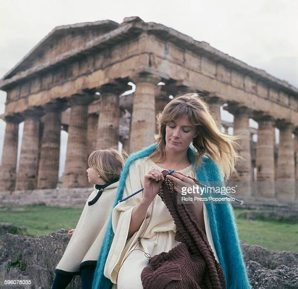 English actress Vanessa Redgrave pictured with her daughter Natasha Richardson hand knitting a garment during a break in production of the film...