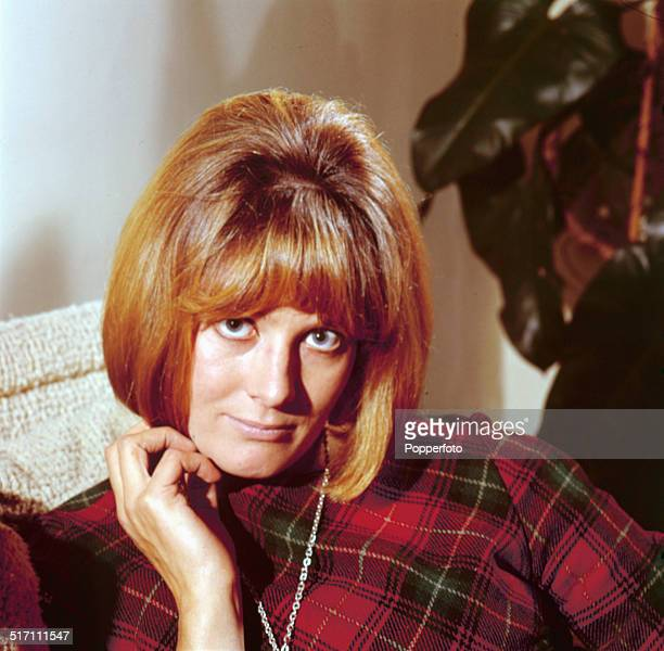 English actress Vanessa Redgrave posed wearing a tartan patterned top in 1964