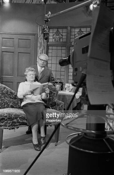 English actress Violet Carson as Ena Sharples and English actor Jack Howarth as Albert Tatlock pictured together in rehearsal during filming for an...