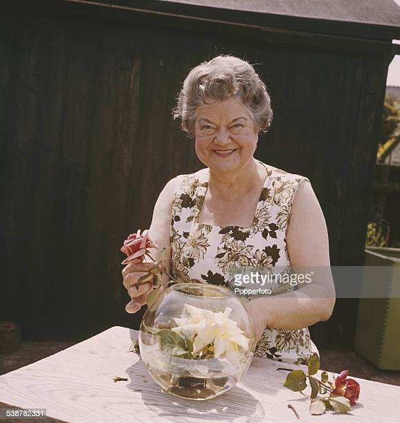 English actress Violet Carson who plays the character of Ena Sharples in the television soap opera Coronation Street pictured arranging cut flowers...