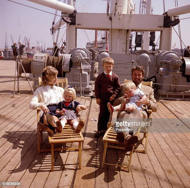 English actress Virginia McKenna pictured with her husband actor Bill Travers and three children on board a ship in 1964