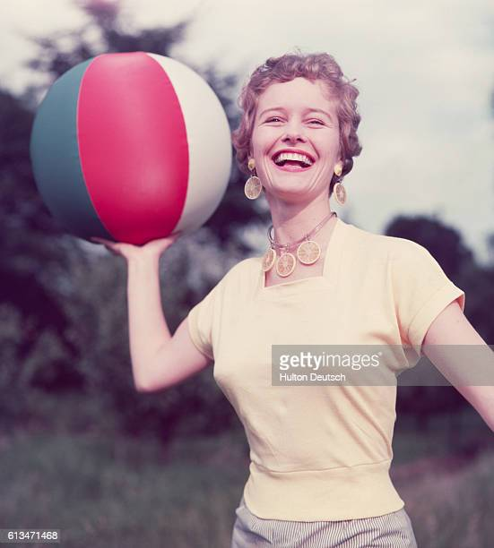 English actress Virginia McKenna playing ball in the park ca 1955