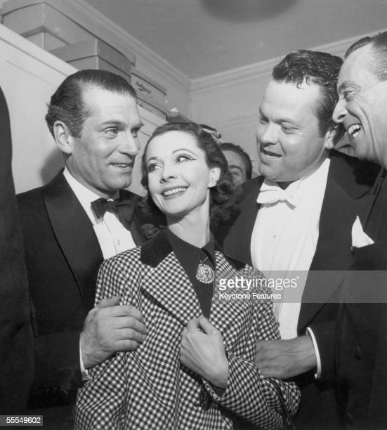 English actress Vivien Leigh her husband Laurence Olivier and fellow thespian Orson Welles attend the Sid Field midnight tribute show at the London...